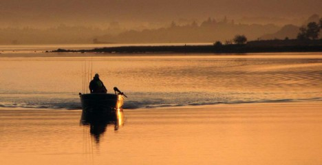 Greenfield Lodge and Lake Bar Gallery - Fisherman returning on Loguh Corrib